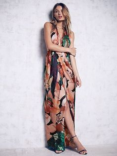 Miami Maxi | In a bold floral and colorful print, this silk maxi gown is all things beautiful and delicate.  Features a plunging V-neckline, with an adjustable halter neck and low back.  Pleat detailing along the skirt with a side slit.  Lined.  Hidden back zip.