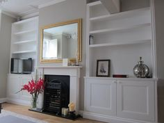 Alcove Units - how to make the most of our space in the family room and hide toys! Alcove Storage Living Room, Built In Shelves Living Room, Living Room Bookcase, New Living Room, Home And Living, Living Room Decor, Dining Room, Living Area, Living Spaces