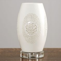 Stunning pierced porcelain lamp with a crystal base.