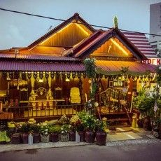 """Kampung Morten - a Malay traditional village, with original Malay roofs and wooden homes built on stilts. These homes are preserved in the middle of the busy Malacca town as a """"living museum""""."""
