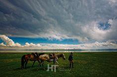 Song Kol lake between Central Asian peaks at altitude 3016m in Kyrgyzstan.