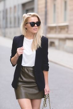 Linda Juhola in green leather skirt from Zara, white top from All Saints and black blazer from Zara