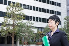 Asain Business Leader Standing in Front of the Building