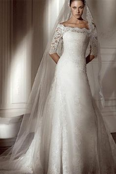Lace wedding dress with sleeves and long veil by mandy