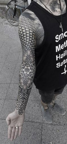 Kenji Alucky's geometric stippled tattoos