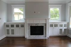 fireplace with tv built ins and windows | fireplace bookshelves with windows -