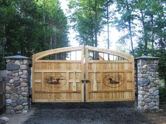 Rustic Cedar Gate with canoe paddle handles.
