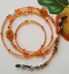 Check out this item in my Etsy shop https://www.etsy.com/listing/506823920/eye-glasses-chain-orange-crystal-glasses