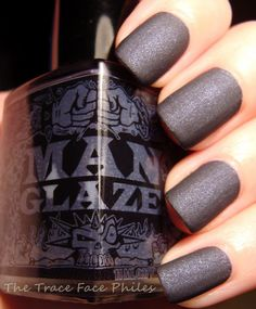 ManGlaze / Cabròn. =)  Looks almost black (until compared to the black) but described as a dark purple matte.  Swatch/pic: Trace Face Philes