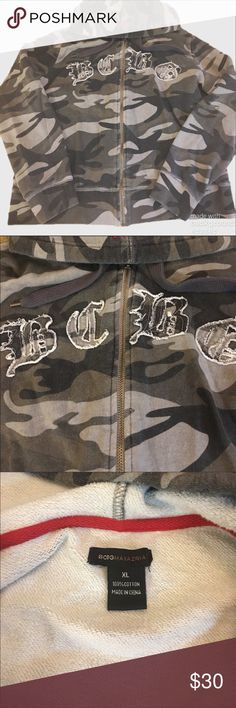 BCBG Camo Hoodie Worn once or twice. Meant to have the worn in faded, Distressed look. Grey/green Camo. Size says XL but fits more like a medium or large. BCBGMaxAzria Tops Sweatshirts & Hoodies