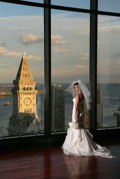Alvina Valenta real bride Ashley in style 9200 overlooks the Boston scenery on her wedding day