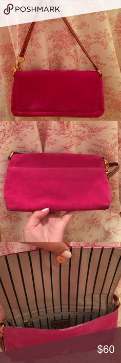 Kate Spade pink suede bag  Beautiful pink suede Kate Spade bag. Suede in good condition with some discoloration on the bottom corners. Leather handle and gold hardware. kate spade Bags