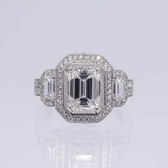 This showstopping beauty features a emerald shape diamond center stone in an elaborate antique style platinum setting. Diamond Ring Cuts, Emerald Diamond, Emerald Cut Engagement, Meaningful Jewelry, Designer Engagement Rings, Fine Jewelry, Wedding Rings, Wedding Ideas, Stone
