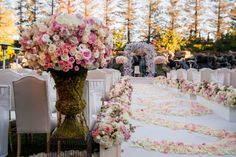 Stunning floral arrangements, pale pink rose petals along the aisle runner and the breathtaking backdrop of our waterfall and sequoias set the perfect scene for this outdoor ceremony. Event design by Exquisite Events, Megan Stark Photography, Tick Tock Florals
