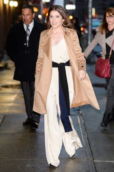Anna Kendrick was spotted on her way to a talk show in New York wearing a cream, wide-leg jumpsuit with a black sash and a camel coat. More celebrity style inspiration here: http://www.harpersbazaar.co.uk/fashion/style-files/news/g37370/best-dressed-this-week-14-november/
