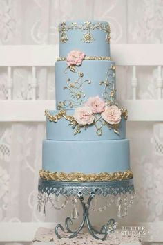Gorgeous blue wedding cake with gold detail and pink flowers.  Love this cake....so pretty! ᘡղbᘠ: