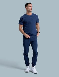 Crew Neck Raglan Top in Estate Navy Blue is a contemporary addition to men's medical scrub outfits. Shop Jaanuu for scrubs, lab coats and other medical apparel. Nursing Clothes, Nursing Outfits, Jaanuu Scrubs, Scrubs Outfit, Medical Scrubs, Jogger Pants, Crew Neck, Lab Coats, Navy Blue