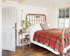 White Bedroom with Brass Bed and Red Plaid Blanket