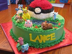"""Pokemon Cake Three chocolate 12"""" layers on the bottom, covered in buttercream with gumpaste figures. The Pokeball was made using the..."""