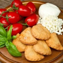 Panzarotti, also spelled panzerotti, are are deep fried pockets of dough stuffed with a variety of fillings and are commonly found in southern Italy.