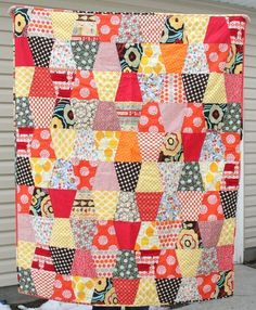 This one was REALLY hard for me to make myself finish once the Christmas decorations were out.   I did some super simple quilting along every other tumbler, and with a soft flannel back it gives it…