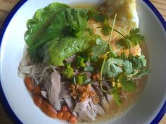 A chinese rice noodle with boiled chicken breast and ' kichi '