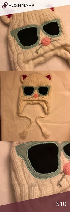 Cute Knitted Kitty Beanie 😻 USED: Cute Knitted Kitty Beanie 😻 MEEEOOOWWW! Cute and cuddly, but also fierce and fun.  Perfect for Winter season, Costume Parties, or any kitty-occasions.😺 Color: White Size: One size Condition: Good (some pilling on Knitted fabrics) Accessories Hats