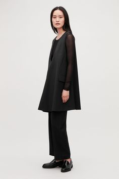 fe575e4e9a Model side image of Cos tailored wool a-line dress in black