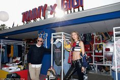 Showcase! Tommy Hilfiger and Hadid posed beside a display of their collaboration, Tommy X Gigi