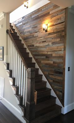 You could wood strip the wall down the stairs and around the corner to the right and along the wall in front of the hot water heater. Too much?