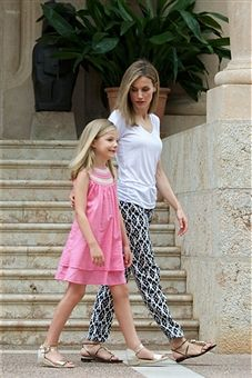 Queen Letizia of Spain (R) and her daugther Princess Sofia of Spain (L) pose for the photographers at the Marivent Palace on August 5, 2014 in Palma de Mallorca, Spain.