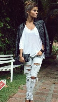 If you are brave enough to rock the  distressed light blue jeans with leather look keep the rest of the look clean and simple. This white Alexander Wang T t-shirt off-sets this look and the heels give this girl an uptown glamour that is cool without even trying. x