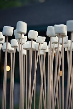 Pre-poke marshmallows onto dowel rods for a backyard cookout (for s'mores)