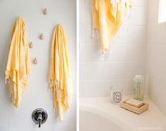 Turkish bath towels hung on Normann Copenhagen Drop It wall hooks