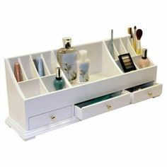 "Three-drawer cosmetic organizer in white with multiple open compartments.  Product: Cosmetic organizerConstruction Material: MDFColor: WhiteFeatures:  Three drawers13 Open compartments Dimensions: 9"" H x 24"" W x 6"" D"