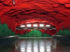 """The Stockholm County Metro Subway in Sweden is quite an architectural marvel; I think you'll agree. The subway system has 100 uniquely-designed stations, with 47 underground and 53 above ground level. After occasionally travelling on the boring, non-decorated London Tube, I can attest to how much I  admire this stunning architecture. From painted tunnels, rainbows, red walls and mood-lit spaces, this """"subway art"""" is simply astonishing…"""