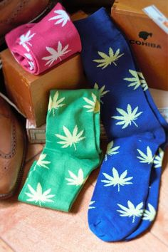 Your feet need to have some fashion too and why not try out these fun and fashionable socks with marijuana leaves.  In Pink, Green and Blue . . . sure to strike up a . . . conversation.  https://www.momandpopsocks.com/products/colorful-mens-dress-socks-random-set-of-three and use discount code PIN10 for 10% off.