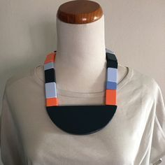Kate Spade Saturday Art Block Necklace This is a beautifully made necklace from Kate Spade Saturday. Brand new with tag and never been worn. The necklace has an architectural look and is comprised of orange and various blue blocks. It has a magnetic closure. The semicircle pendant has a small nick as shown in the photos. Otherwise this necklace is great! Kate spade saturday Jewelry Necklaces