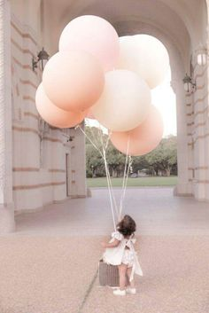 Biggest pink balloons she has ever seen!