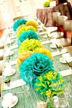 Real Baby Shower: Teal and Green Tissue Pom Masterpiece from www.babylifestyles.com #babyshower