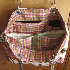 Free Sewing Pattern: Laptop Tote Bag...Here's a free sewing pattern for a laptop tote bag.  Since I'm always carrying my laptop around, this bag will be perfect.  I absolutely love all of the pockets!  Thanks to Just Crafty Enough for posting it.