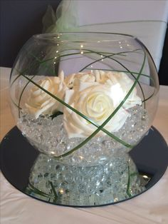 Ivory and green simple and elegant fish bowl wedding centrepiece. Hire in South Wales from www.affinityeventdecorators.com