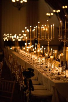 Tall candelabras (and plenty of shorter flames) made this New Year's Eve wedding really sparkle. Click for more pictures.