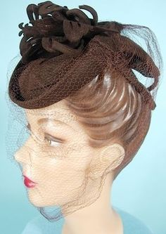 1944 ___ Brown Toy or Tilt Hat ___ Also called a doll hat, but it's not for little girl's doll... but rather it's for a woman who is a doll! The mass of brown felt at the top is actually cutout butterflies!!! ____MILGRIM Dept Store ____ photo 1