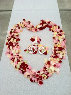 """Dress up your wedding aisle runner with these beautiful fresh flowers with matching wedding colors. Just so happens my wedding boutique is named """" I DO WEDDINGS"""", so perfect for this event."""