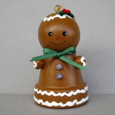 This sweet little Gingerbread Bell is all decked out with icing, gum drop buttons, a green bow, and holly berries. She is about 2 3/4 tall and made from a small clay flowerpot with a bell inside. She has a cord for hanging or can just sit on a shelf. All of my ornaments are original creations.  A great idea for a gift.  Thanks for checking out my shop.