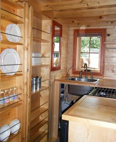 "Did you say you have no cabinet space? Did I say you only needed 4"" to store a lot of glassware? Look at this idea! @JoeTHH www.tinyhousehacks.com"