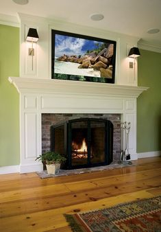 A traditional custom fireplace mantel with flat screen tv above built by Premier Builders' Architectural Millwork division. Custom Fireplace, Fireplace Remodel, Fireplace Mantle, Living Room With Fireplace, Fireplace Surrounds, Fireplace Design, Home Living Room, Cottage Fireplace, Living Room Decor Traditional