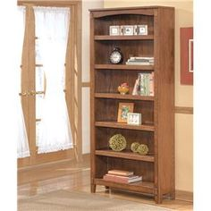 Cross Island Large Bookcase by Ashley Furniture at Marlo Furniture in Oak finish