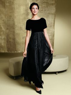 An inverted front pleat releases into a soft layer of chiffon over taffeta. Velvet bodice with ballet neckline in the front and back. The Capri dress is shipped with an extra long skirt to be cut to desired length and hemmed. Dry clean. Black only. Please